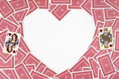 心形由红色纸牌做成 免版税库存图片