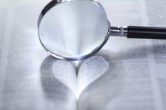 心形的光通过放大镜 免版税库存图片