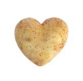 心形的金黄土豆用小锄头 库存图片