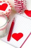心脏、笔记本和蜡烛 库存照片
