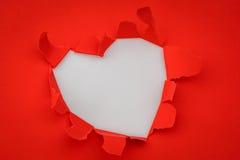 心脏与空间的被撕毁的纸文本的 库存图片