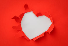 心脏与空间的被撕毁的纸文本的 免版税库存照片