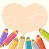 心脏与铅笔的讲话泡影。轻的背景 库存图片