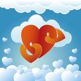 心脏和云彩在蓝色背景 免版税图库摄影