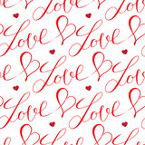 心脏和信件无缝的样式 免版税库存图片