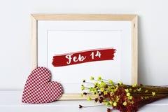 心脏和文本在图片的2月14日 免版税库存图片