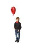 心脏在一个小男孩的手上 免版税图库摄影