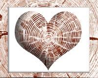 心脏在木框架的树桩样式 免版税图库摄影