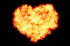 心脏填装了做通过烧火焰在黑背景充满火微粒、情人节和爱 库存照片