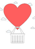 心脏形状有篮子的热空气气球 免版税库存照片