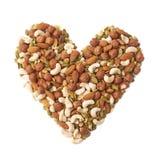 心脏形状由坚果和种子制成 库存图片