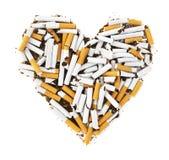 心脏形状香烟 免版税库存图片