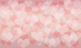 心脏样式bokeh背景;桃红色和红颜色 库存图片