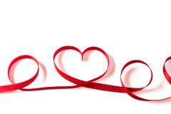 心脏由丝带制成在白色背景 库存照片