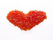 心脏由红色鱼子酱制成 库存照片