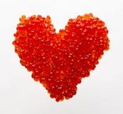 心脏由红色鱼子酱制成 免版税库存图片