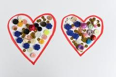 心脏由纸和小珠做成 免版税库存照片