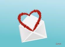 以心脏的形式五彩纸屑飞行在信封外面 库存照片