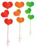 以心脏的形式五颜六色的气球 免版税库存图片