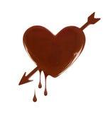 以心脏的形式巧克力污点与箭头 免版税图库摄影