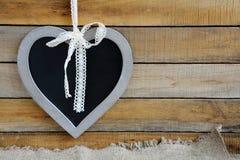 以心脏的形式粉笔板 免版税库存照片