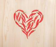 以心脏的形式,很多辣椒是 免版税库存图片