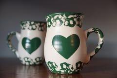 心脏装饰了杯子 库存照片