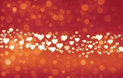 心脏bokeh背景 在可爱的bokeh背景的充满活力的发光的心脏 皇族释放例证