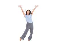 快乐优等女实业家跳跃 免版税库存照片