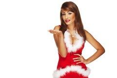 快乐的圣诞老人辅助工女孩的照片 免版税库存照片
