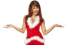 快乐的圣诞老人辅助工女孩的照片 免版税图库摄影