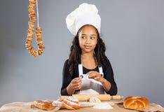 快乐的女孩厨师 库存图片