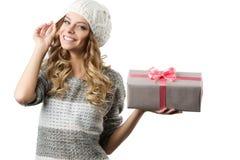 快乐的女孩的图片有礼物盒的在白色背景 图库摄影