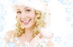 快乐的女孩辅助工圣诞老人 图库摄影