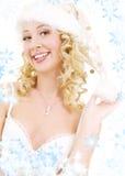 快乐的女孩辅助工圣诞老人 免版税库存图片