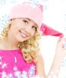 快乐的女孩辅助工圣诞老人 库存照片
