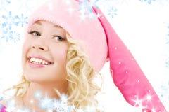 快乐的女孩辅助工圣诞老人 免版税图库摄影