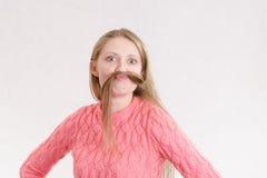 快乐的女孩髭做了锁头发 免版税库存图片