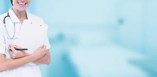快乐的女性医生画象的综合图象拿着剪贴板的  图库摄影