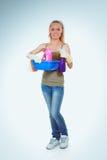 快乐的妇女清洗某事与小捆和浪花殷勤地 库存照片