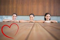 快乐的少妇的综合图象游泳池的 免版税库存图片
