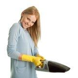 快乐的擦净剂手持式真空妇女 免版税库存图片
