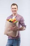 快乐的适合人喜欢吃维生素 免版税库存照片