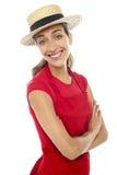 快乐的面包师妇女佩带的秸杆圆顶硬礼帽 库存图片