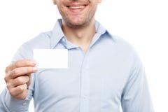 快乐的年轻人提出他的文件 免版税库存图片