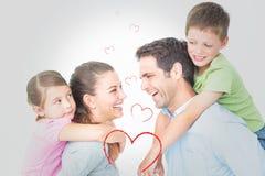 快乐年轻家庭摆在的综合图象 免版税库存照片