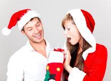 快活圣诞节的夫妇 库存照片