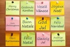 快活12种圣诞节的语言 库存照片