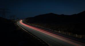 从快行汽车的光足迹 库存照片
