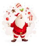 快活的圣诞老人玩杂耍与圣诞节礼物和甜点作为魔术师 免版税库存照片
